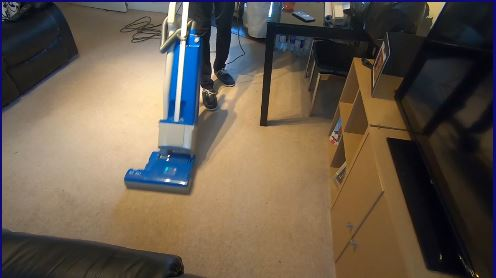 Carpet being vacuumed as part of our professional service.